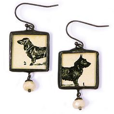 Vintage dog illustrations are reproduced and arranged under hand-cut glass. The images are framed with hand-soldered lead-free silver and oxidized to provide a rich, dark tone. The final touches are provided by an oxidized sterling silver french wires and faceted cream accent beads! Best of all, the earrings provide the benefit of being reversible - The dachshund head/tail appears on one side and the scottish terrier head/tail appears on the other! Handcrafted in Minnesota. #madeinusa