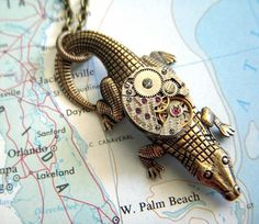 Steampunk Necklace Cosmic Crocodile - Vintage non-working Swiss watch movement is over 50 years old and no longer functions. The movement even has a little pattern on its surface that looks like scales and match the crocodile's skin. #Jewelry