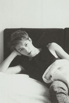 EXO yixing bw staring at you from his bed with that stare. I died. #lay