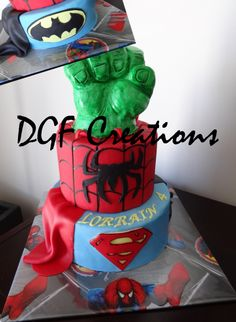 Superhero birthday cake batman (in the back), Superman, Spiderman and the Hulk.  The Hand of the hulk is also edible and hand painted.  www.facebook.com/dgfcreations