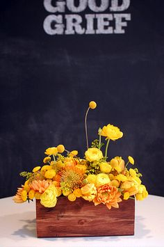 use different flowers in the same shade for centerpieces