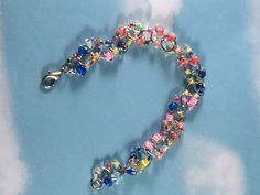 A personal favorite from my Etsy shop https://www.etsy.com/listing/489323578/colorful-beaded-chainmaille-bracelet