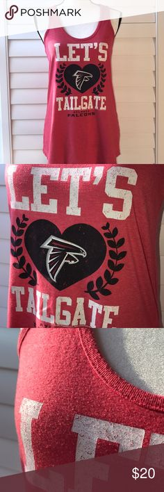 "ATLANTA FALCONS TANK TOP NFL BRAND RED LADIES NFL brand Atlanta Falcons  Ladies size large  Red color Tank top Let's Tailgate  Falcons logo in black heart Gently worn but does have minor piling. Quick shipping 🚚 Instagram: bargaingirl66  Facebook: South Atlanta Poshers  Bust measures approximately 17"" Shoulder to hem measurement is approximately 28"" NFL Tops Tank Tops"