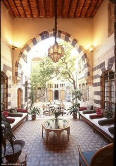 How gorgeous! I love the large archway and communal seating