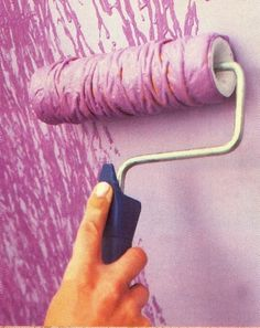 Tie yarn around a paint roller for an awesome effect! Cool for an accent wall