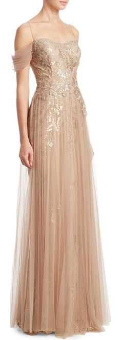 off-the-shoulder pleated tulle evening gown by Teri Jon by Rickie Freeman. Polyester-blend gown finished with chiffon overlay. Sweetheart neckline. Off-the-shoulder. Short sleeves. Concealed b...