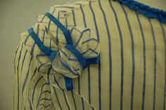 A blue and white striped gauze summer gown, circa the bodice with square neckline, flounced sleeves, peplum trimmed with blue satin, blue ribbon belt with later added bow. Ribbon Belt, Blue Ribbon, Summer Gowns, Victorian Women, Victorian Dresses, Old Dresses, Period Outfit, Square Necklines, Blue Satin