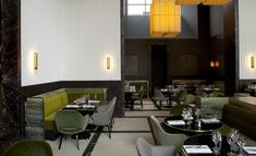 Although its name is an oblique nod to Yves Klein, Monsieur Bleu is devoid of the artist's signature electric blue. Instead, the impressive new restaurant in Paris' Palais de Tokyo is a dramatic space warmed by burnished bronze and mossy green, the...