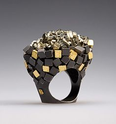 Ring   Ornella Iannuzzi.  Pyrite set in silver black rhodium plated and gold leaves