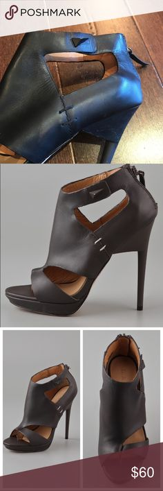 """L.A.M.B. Amanda Booties Open Toe Black Heels These leather thong booties feature cutouts and a pyramid stud at the ankle strap. Zip at heel cap. Covered platform and stiletto heel. Leather sole. * Heel: 4.75"""" (120 mm). * Platform: 1/2"""" (1 cm). * Leather: Cowhide. * Imported. Size: 7M Very good used condition as pictured.The Matte coating on the heels has some areas that are rubbed off and appear slightly glossy. Please view all photos. L.A.M.B. Shoes Heels"""