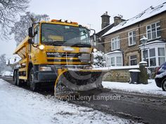 Snow plough in action - stock photo