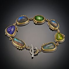 Tanzanite, Labradorite, Green Tourmaline and Vesuvianite Bracelet | Ananda Khalsa Jewelry  |  Rose cut labradorite, tanzanite, green tourmaline and vesuvianite are accented with diamond dots.  Bracelet measures 7 inches with toggle clasp.  22k bezels with sterling silver.  $7,280.00