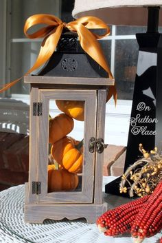 Front Porch Fall 2012 On Sutton Place-Cute idea with the mini pumpkins in a lantern. Simple and easy. Thanksgiving Decorations, Seasonal Decor, Halloween Decorations, Holiday Decor, Holiday Fun, Autumn Decorating, Porch Decorating, Jardin Decor, Fall Lanterns