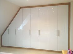 As bespoke wardrobe designers and manufacturers Clive Anderson Furniture are fully aware that our fitted wardrobe has the ability Slanted Ceiling Bedroom, Attic Bedroom Storage, Bedroom Built Ins, Bedroom Closet Design, Wardrobe Door Handles, Oak Wardrobe, Attic Wardrobe, Built In Wardrobe, White Fitted Wardrobes