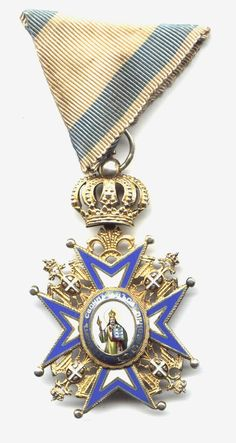 Military style medals - I believe this is the Order of St. Sava (I have to check and come back for this one)