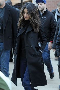 Selena Gomez winter street style with black coat.