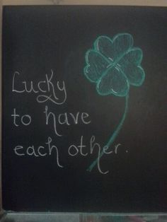 St. Patrick's day lucky four leaf clover chalkboard art. Lucky to have each other.