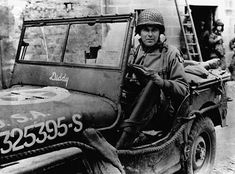 General Maxwell Davenport Taylor behind his Willy's Jeep in Normandy. Taylor took part in the division's parachute jump into Normandy on June 6, 1944, the first Allied general to land in France on D-Day, June 6 1944. He commanded the 101st Airborne Division for the rest of the war, including Operation Market Garden in The Netherlands.