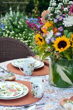 Garden table and floral arrangement with Kim Parker Woodland Floral dinnerware by Mikasa | homeiswheretheboatis.net #alfresco #tablescape