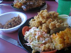 Traditional Bahamian cracked conch, macaroni & cheese, cole slaw, and peas and rice.