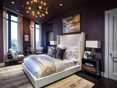 A color palette of plum purple, ivory and gold invites glitz and glamour into the master bedroom.
