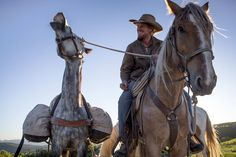 Ben Masters rides his mustang Luke while leading another horse in the film 'Unbranded.'