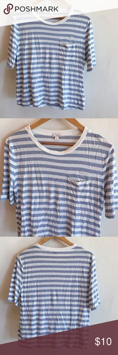Gap Tee Gap 100% viscose-very soft and slinky! Size S, will fit M. This is the perfect tee paired with jeans. Slightly cropped and boxy with a small breast pocket. White and chambray stripes. I've worn with sleeves rolled up, looks cute with everything! No flaws. GAP Tops Tees - Short Sleeve