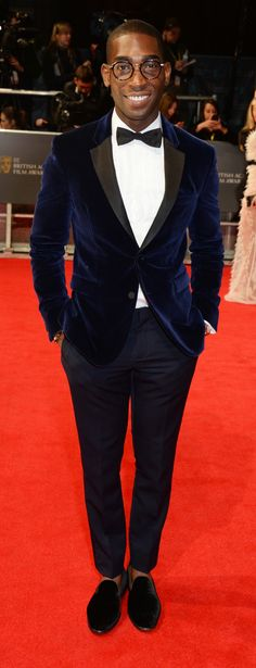 British musician Tinie Tempah wearing a Burberry tuxedo on the BAFTAs red carpet in London