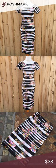 """🆕🎁 Forever 21 Two Piece Skirt Set Two piece skirt & crop top set is 95% Polyester & 5% Spandex. Black & white stripes with floral design. Skirt measurements are 28"""" long, 13.25"""" waist relaxed & stretched is 17.5"""". Top measurements are 14.5"""" long from shoulder to bottom of top & 15.5"""" pit to pit. In excellent like new condition with NO damage. Forever 21 Dresses"""