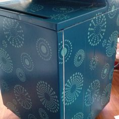 Painted our stacked washer & dryer with kaleidoscope stencil.