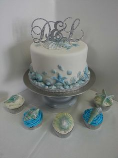 One Tier Seashell Wedding Cake and Cupcakes decorated with chocolate shells