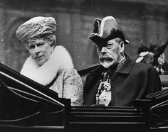 1928: King George V and Queen Mary in a carriage on their way to the Knights of St. John ceremony at Westminster Abbey.