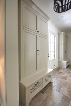 Mudroom with built in cabinets and benches