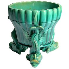 WARDLE Majolica Cache Pot  England  19th century  Graceful late 19th century English majolica dolphin footed cache pot or garden pot with striking green-turquoise ground. Impressed: Wardle, England.