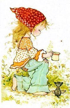 Menina dando leite ao gato