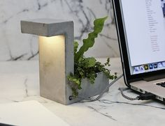 Go green with this concrete desk lamp and mini planter. Made from Concrete. Simply plug the lamp into any USB port to enjoy its warm white LED light. Concrete Light, Concrete Lamp, Concrete Planters, Lampe Ballon, Espace Design, Cool Office Supplies, Deco Originale, Brutalist, Decoration