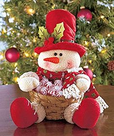 Plush Character Basket looks cute on tables, counters or buffets. He wears a holiday hat with holly and fabric accents and holds an attached bamboo basket that' Cute Snowman, Snowman Crafts, Christmas Snowman, Christmas Stockings, Diy And Crafts, Christmas Crafts, Christmas Decorations, Christmas Ornaments, Holiday Decor