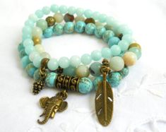 Boho memory wire bracelet made of amazonite, jade and turqouise beads, with silvertone metal beads and beadcaps. The memory wire used in this bracelet is soft and flexible, so it fits all sizes. All metal parts are lead free.   For more jewelry please visit our shop: http://www.minoucbrocante.etsy.com  For combined shipping please contact us. We also combine shipping with our other Etsy shop where we sell vintage fabrics and finds from Holland and France: http://www.minoucbrocante.etsy.com