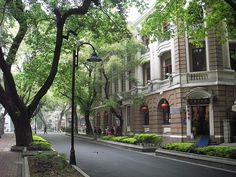 Shamian Island in Guangzhou. Beautiful area of Guangzhou, old Portugese buildings and British Colonial buildings. Lots of Banyan trees and Orchid Trees