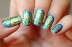 gold shatter polish on top of turquoise nails