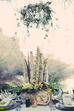 Hanging ivy, wild flowers & tree stump table numbers. Bohemian wedding table setting.