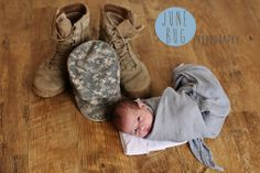 army boots newborn photo. Adorable newborn shot of baby and dad's army boots and hat. By junebugphotography.org