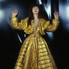 Kate Bush strikes a pose while looking exquisitely beautiful in a spiffy yellow dress late 1970s http://ift.tt/2z0usjH