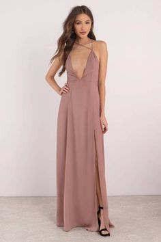 Light up the night with our Khloe Plunging Maxi Dress. Featuring a plunging neckline, high side slit, and open back detail. This dress is surely to ma #shoptobi
