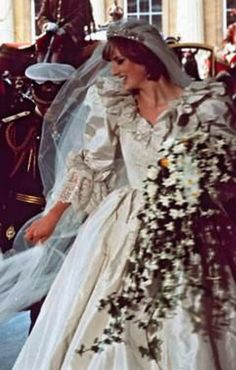 Princess Diana getting out of the carriage at Buckingham Palace. Fairy tale bride and dress, shame about the two timing husband and mistress. I still wouldn't spit on either of them if they were on fire. R.I.P. Di.