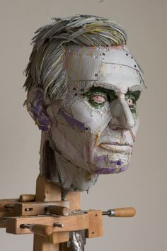 Scott Fife is an American sculptor well-known for his incredibly detailed busts of popular icons, made only from archival cardboard, drywall screws and glue.