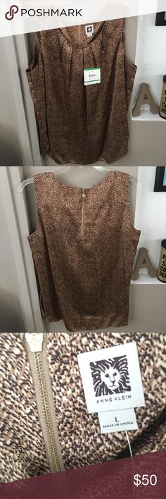 🆕 NWT Anne Klein Top 🌿 New with Tags! 🌿 Size: L - Color: Camel Multi Style: Animal Print  Brand new with tags. Can be worn with flats for a casual look or with high heels for a night out. It is a great addition to any wardrobe!  🌿  N O   T R A D E S   •   H O L D S  🌿  📦 Q u i c k   S h i p p i n g 📦 Anne Klein Tops Blouses
