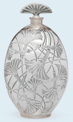 Rene Lalique Perfume Bottle Tantot 15 centimeters tall oval shaped with enameled feather duster type design and fan shaped stopper R. Lalique Perfume Bottle Circa 1925 Japan - Tokyo