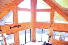 Looking out to mountain views, hot tub, luxury decor, free wi fi & much more! @ www.mtngetawaycabins.com