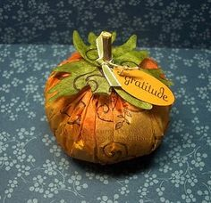 Coffee filter pumpkins.  Try this using big commercial filters.